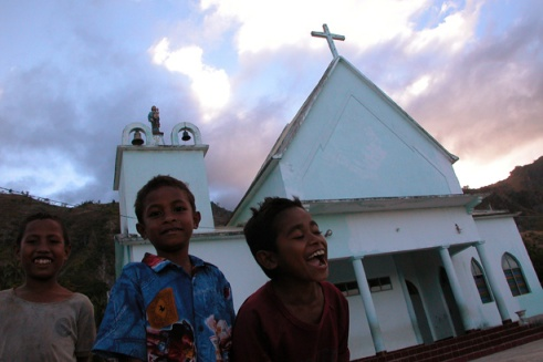 Bagia, East Timor. Children from the church's orphanage play outside to pass the time. (Photo by Maria Bakkalapulo)