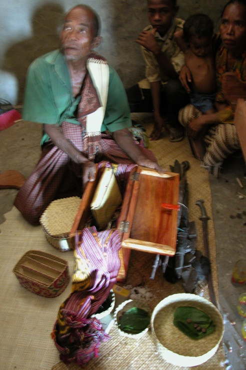 In the district of Maubaru, villagers carefully place the swords, tapestries and jewelry of generations past nside the Umu Lulik, or sacred house.(Photo by Maria Bakkalapulo)