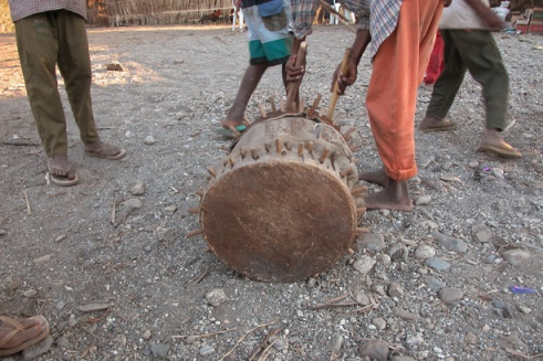 As the sun begins to set, the kids play around a drum that will later be used in a ceremony to honor their ancestors. (Photo by Maria Bakkalapulo)